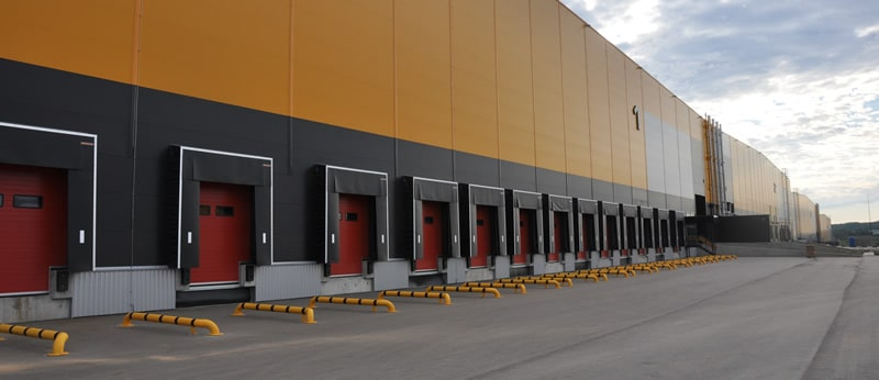 commercial warehouse with closed garage doors